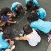 Children draws on the street in Universal, Texas