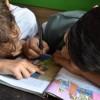 Boys writing in the book in El Paso, Texas