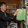Man Arranging Books in Osan, South Korea