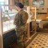 Soldier in a Food Stand in Kentucky, Fort Campbell