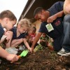 Kids teaching how to plant in Universal, Texas