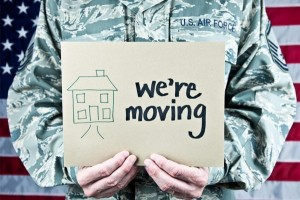military-man-holding-were-moving-sign-1