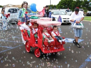 Children Riding in a Stroller with Bubbles in Wahiawa, Hawaii